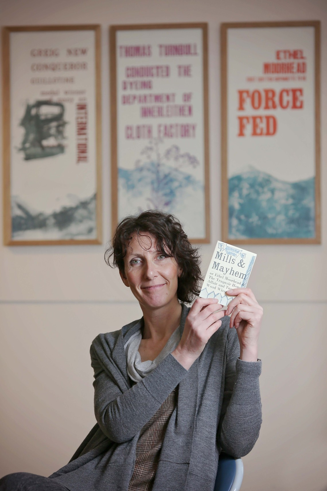 Robert Smail's Printing Works, the National Trust for Scotland is celebrating its 150th anniversary this year. Future/Past is an exhibition to celebrate. Theresa Easton, an artist from Newcastle is exhibiting some of her work. She has created chap books and broadsides, which were all designed at the print works. Photographed holding a chap book